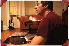 Peter playing harmonium - Bhakti Breakfast Club testimonial